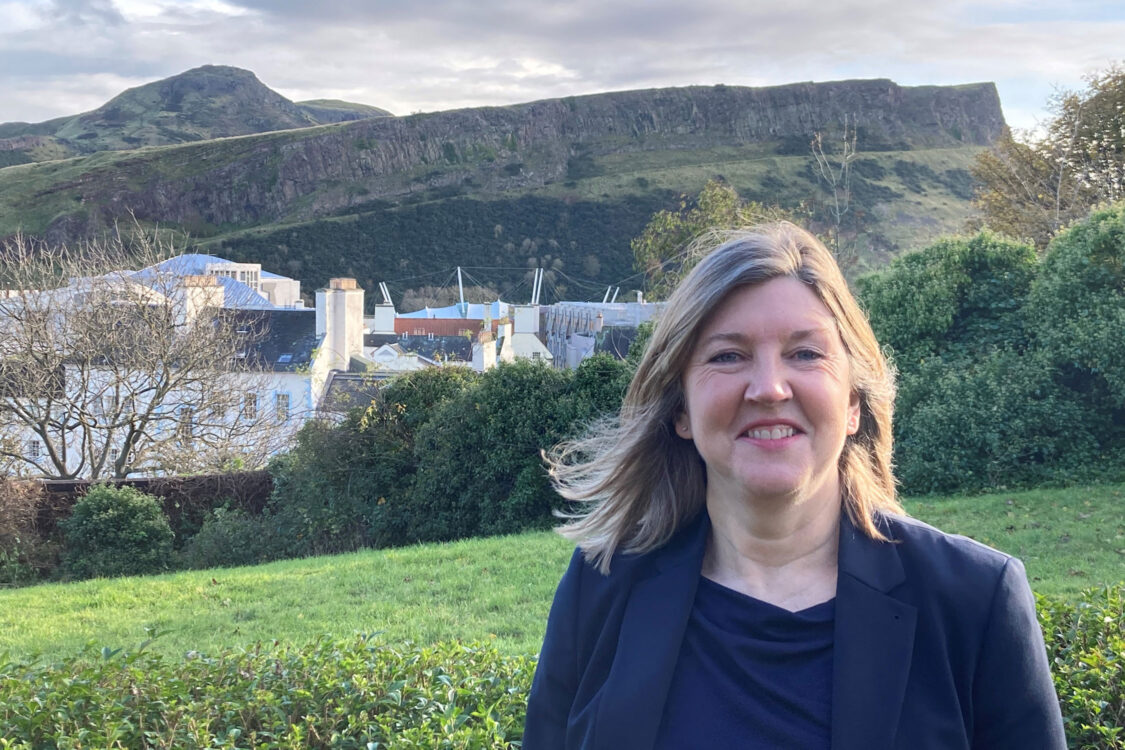 Alison Johnstone with Holyrood Park in background