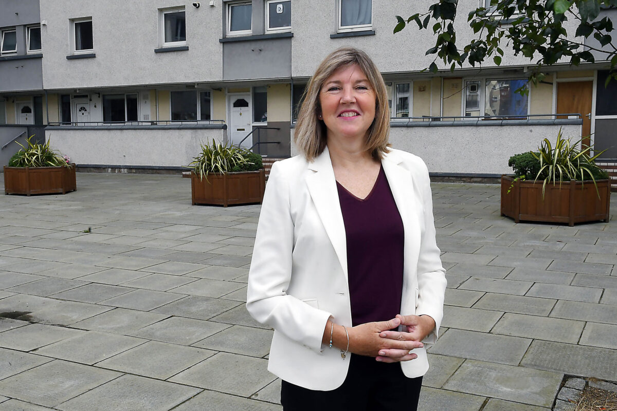 Alison Johnstone in front of block of flats