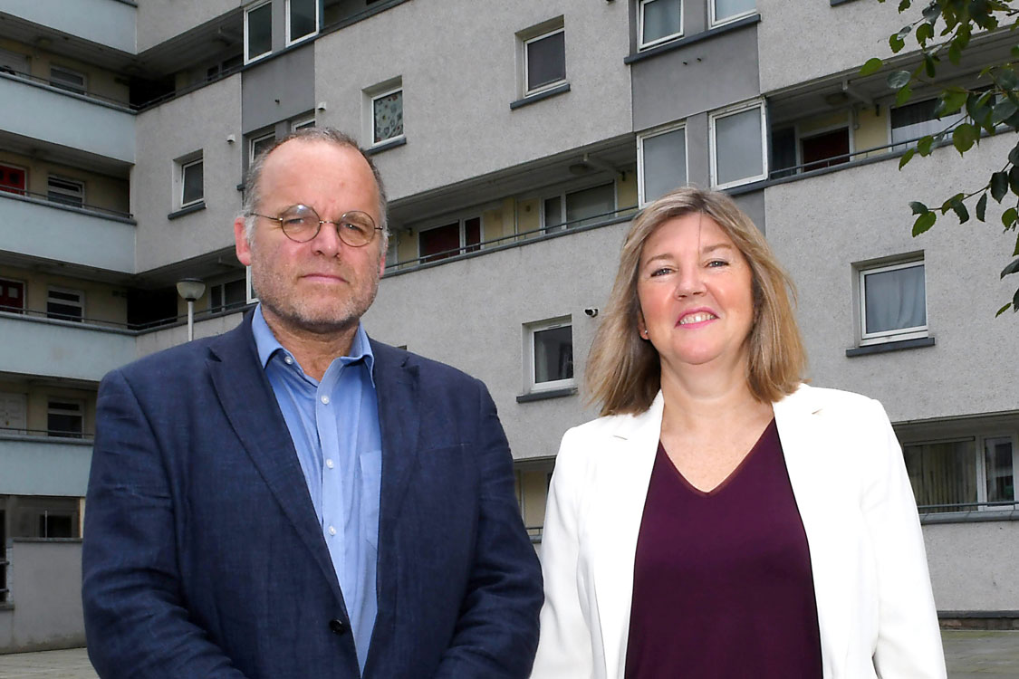 Andy Wightman and Alison Johnstone in front of Lochview Court flats