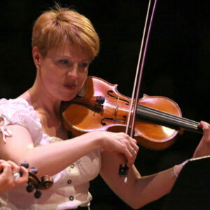 June Nelson playing the fiddle