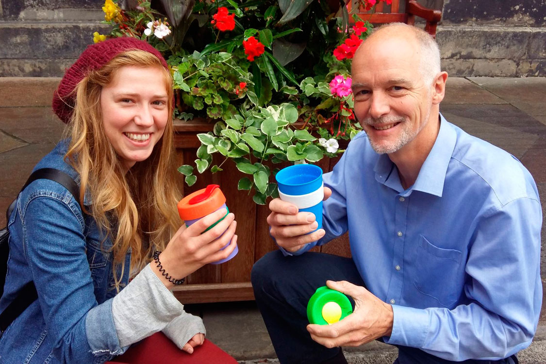 Katri Hastings and Steve Burgess with reusable portable coffee cups