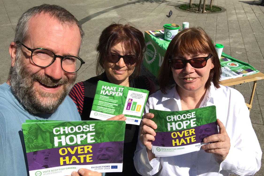 3 campaigners holding up 'Choose Hope over Hate' leaflets