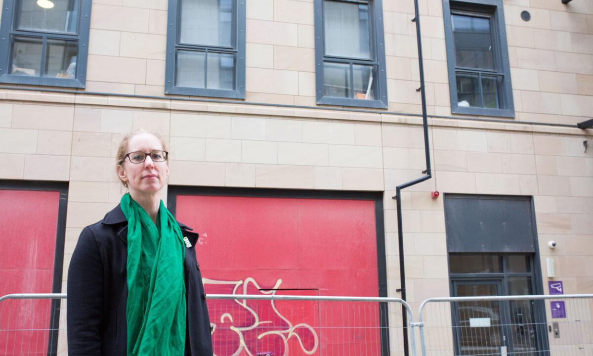 Lorna Slater outside housing block