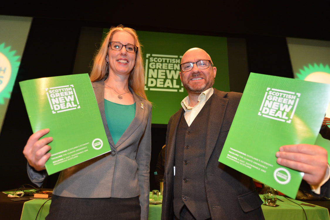 Lorna Slater and Patrick Harvey holding 'Scottish Greens New Deal' document