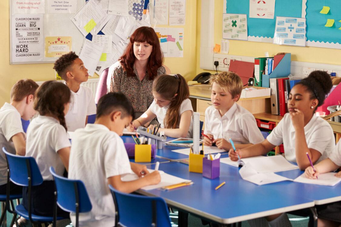 Primary school classroom with teacher and children