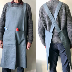 Grey studio apron with cross-over straps and front pocket